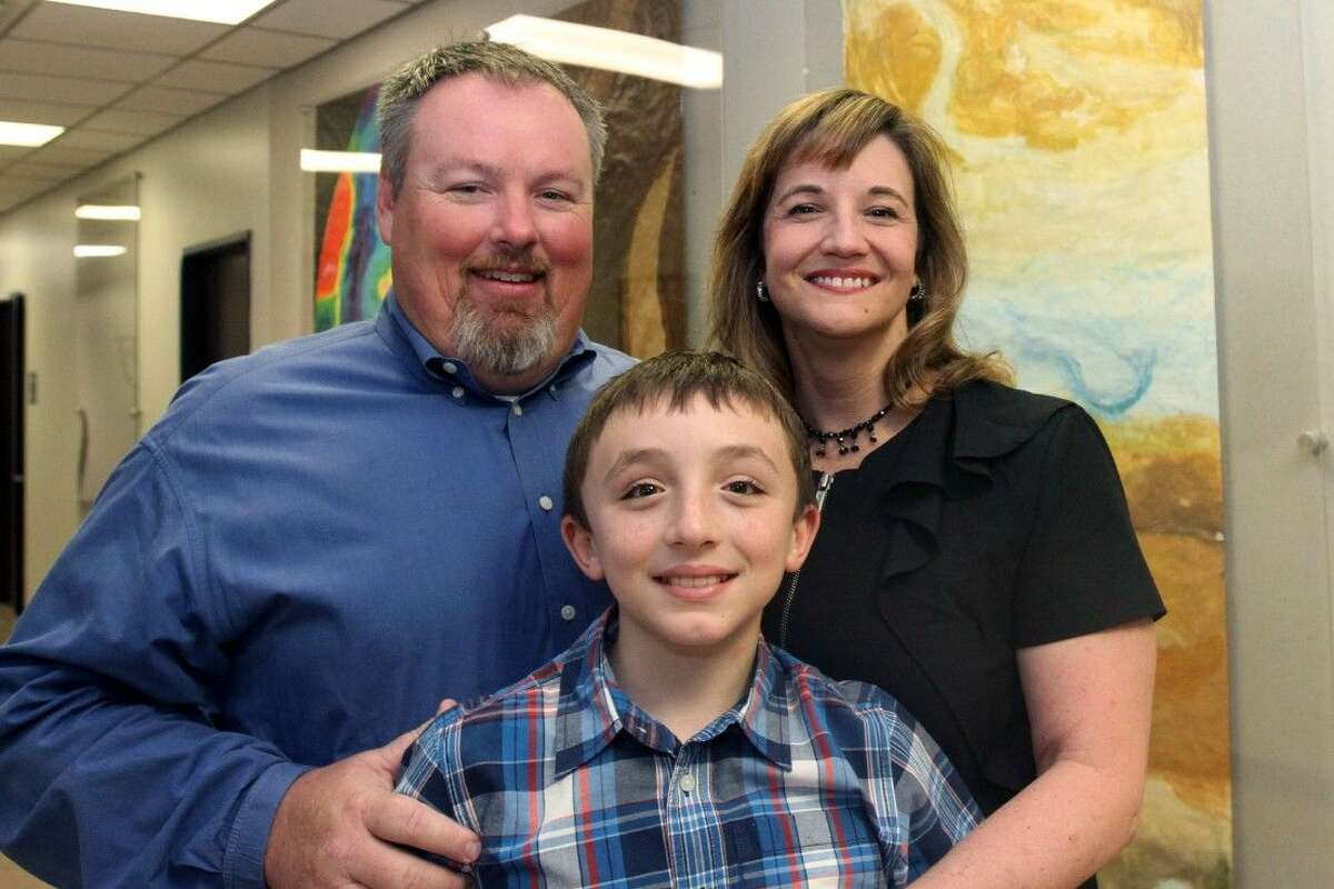Pictured: New Schneider Middle School Principal Kristin Still with her husband Benjamin and son Ben.