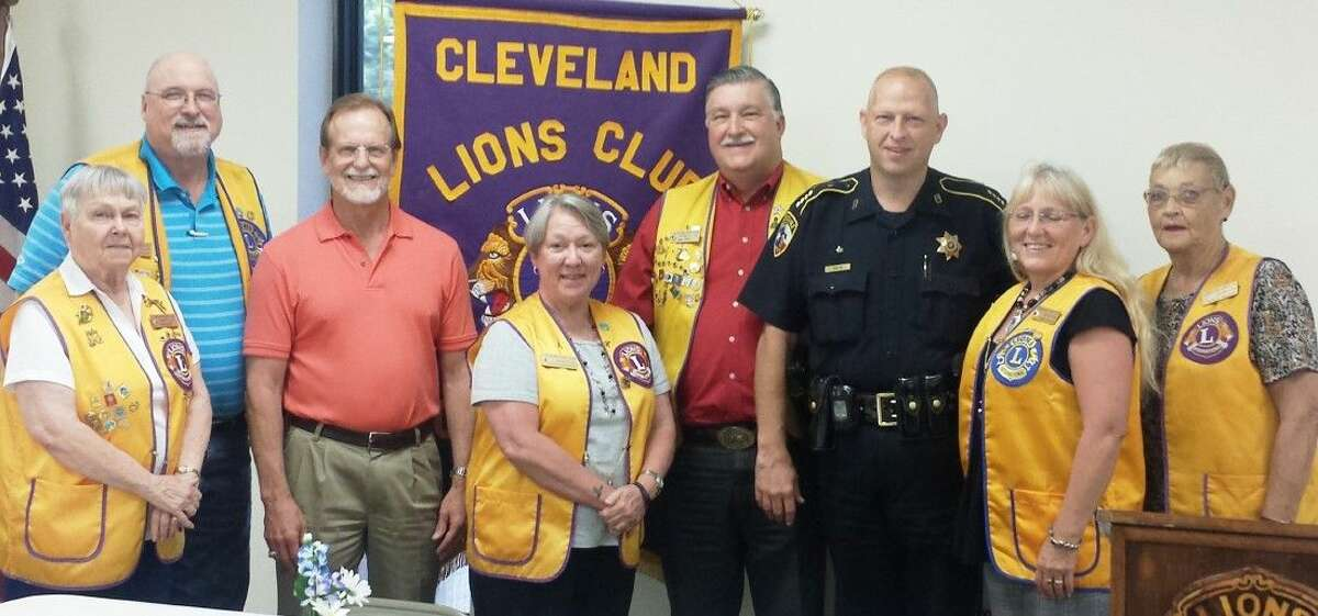 Cleveland Lions Club members Doris Butler, Tim Holder, Sharon Anderson, Mike Penry, Liberty County Pct. 6 Constable John Joslin, Terrie Manners and Estelle Trevathan welcome guest speaker Jay Rice (third from left) at the July 28 meeting.