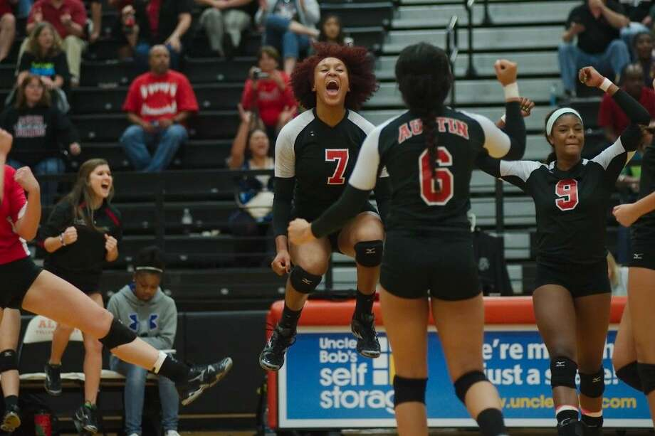 Fort Bend Austin's Cristen Coryatt (9) and Erica Anthony (6) celebrate a point against Clear Springs with 2014 graduate Nia Johnson in last year's bi-district playoff. The Lady Bulldogs won the Spring Branch ISD Tournament on Aug. 23. Photo: Kirk Sides