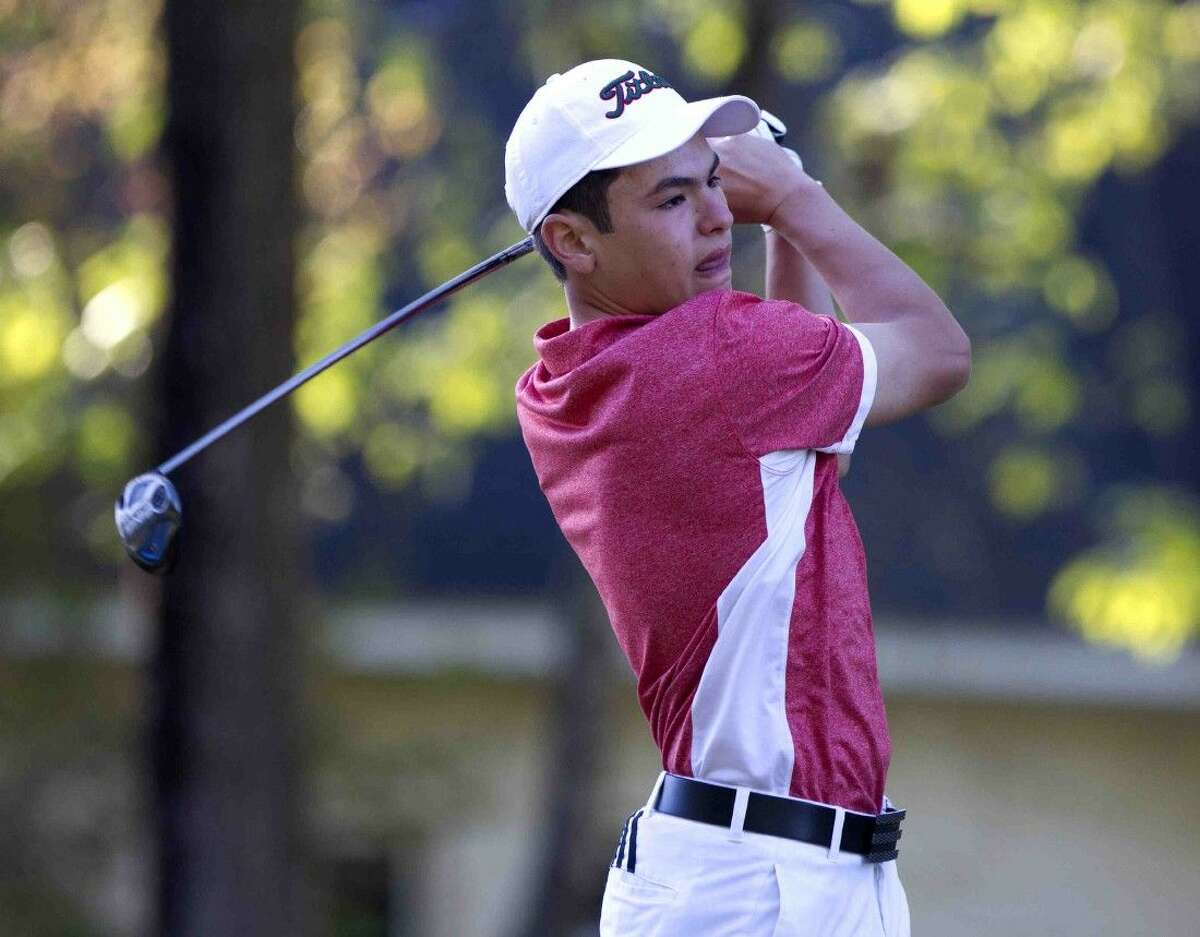 The Woodlands' Andres Anzaldua hits his tee shot off the first tee box during the final day of the District 16-6A boys golf championship at High Meadow Ranch Golf Course Tuesday in Magnolia.
