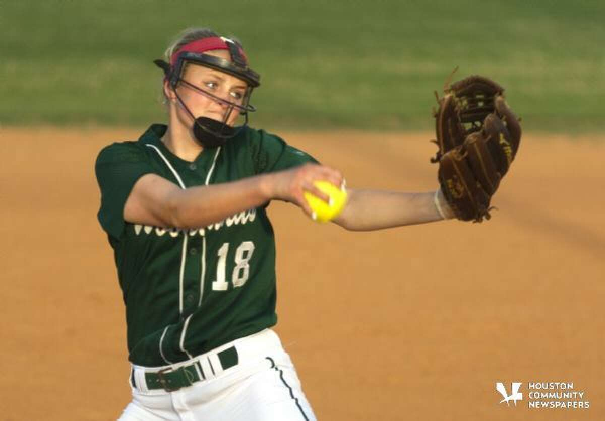 The Woodlands pitcher Emily Langkamp throws during the second inning of a District 16-6A softball game March 12, 2016
