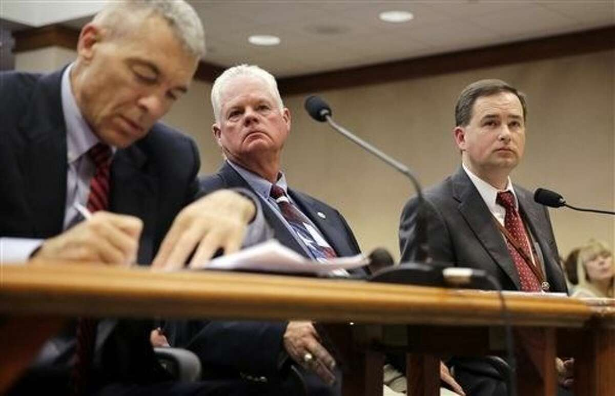 Texas Department of Public Safety Deputy Director Steve McCraw, left, Limestone County Sheriff Dennis Wilson, center, and Executive Director of the Texas Commission on Jail Standards, testify before the Texas County Affairs Committee hearing to discuss jail standards in the wake of the Sandra Bland case, Thursday in Austin.
