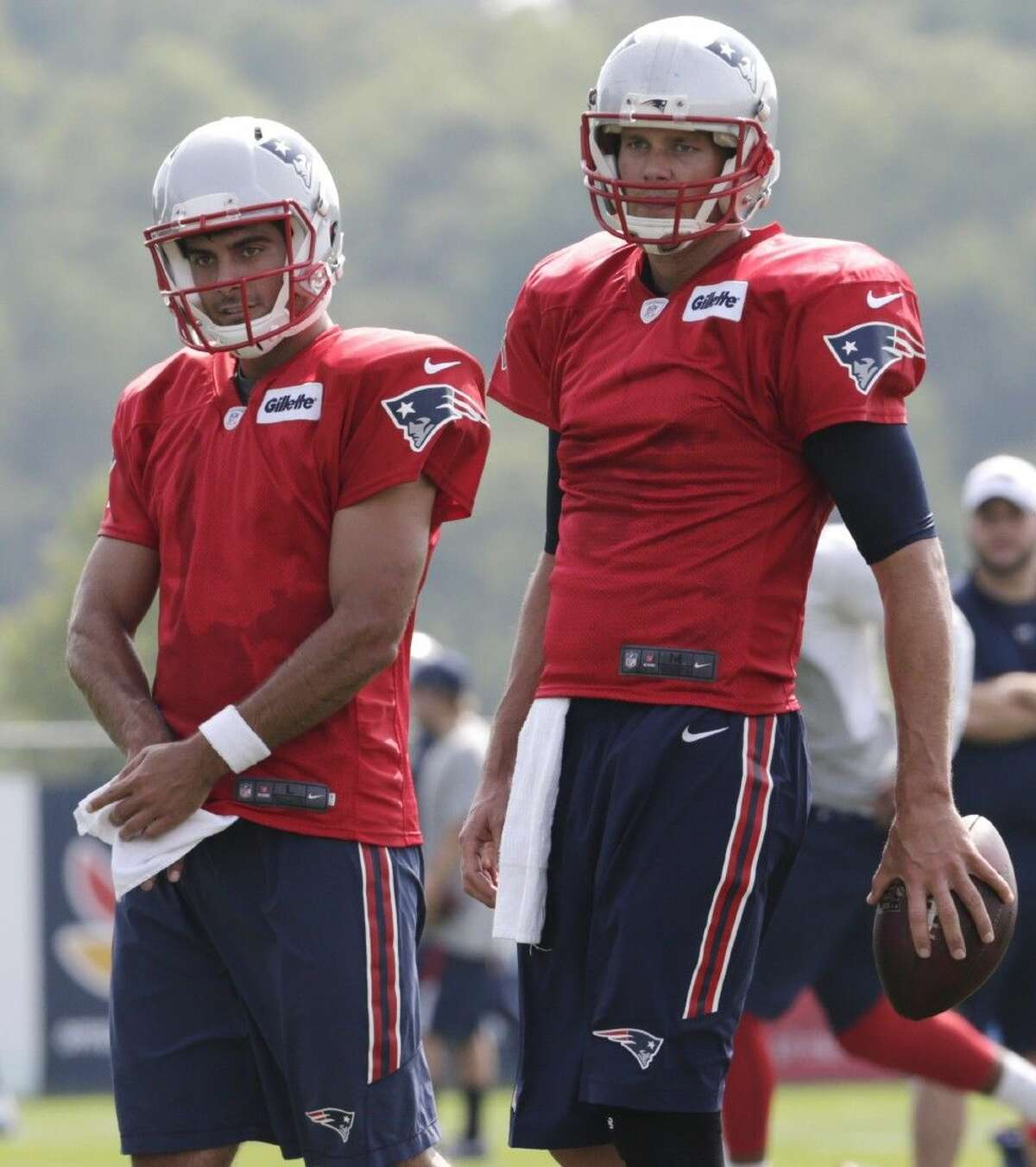 New England Patriots quarterback Tom Brady, right, and Jimmy Garoppolo pause for a break during an NFL football training camp in Foxborough, Mass., Thursday.