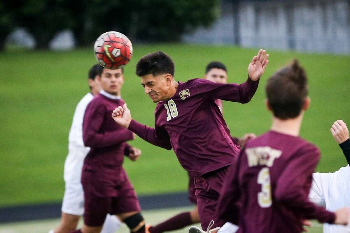 Magnolia West's Jonathan Gomez(18) heads the ball during the high school boys soccer game against A&M Consolidated on Friday, April 1, 2016, at Moorhead Stadium. To view more photos of the game, go to HCNPics.com.
