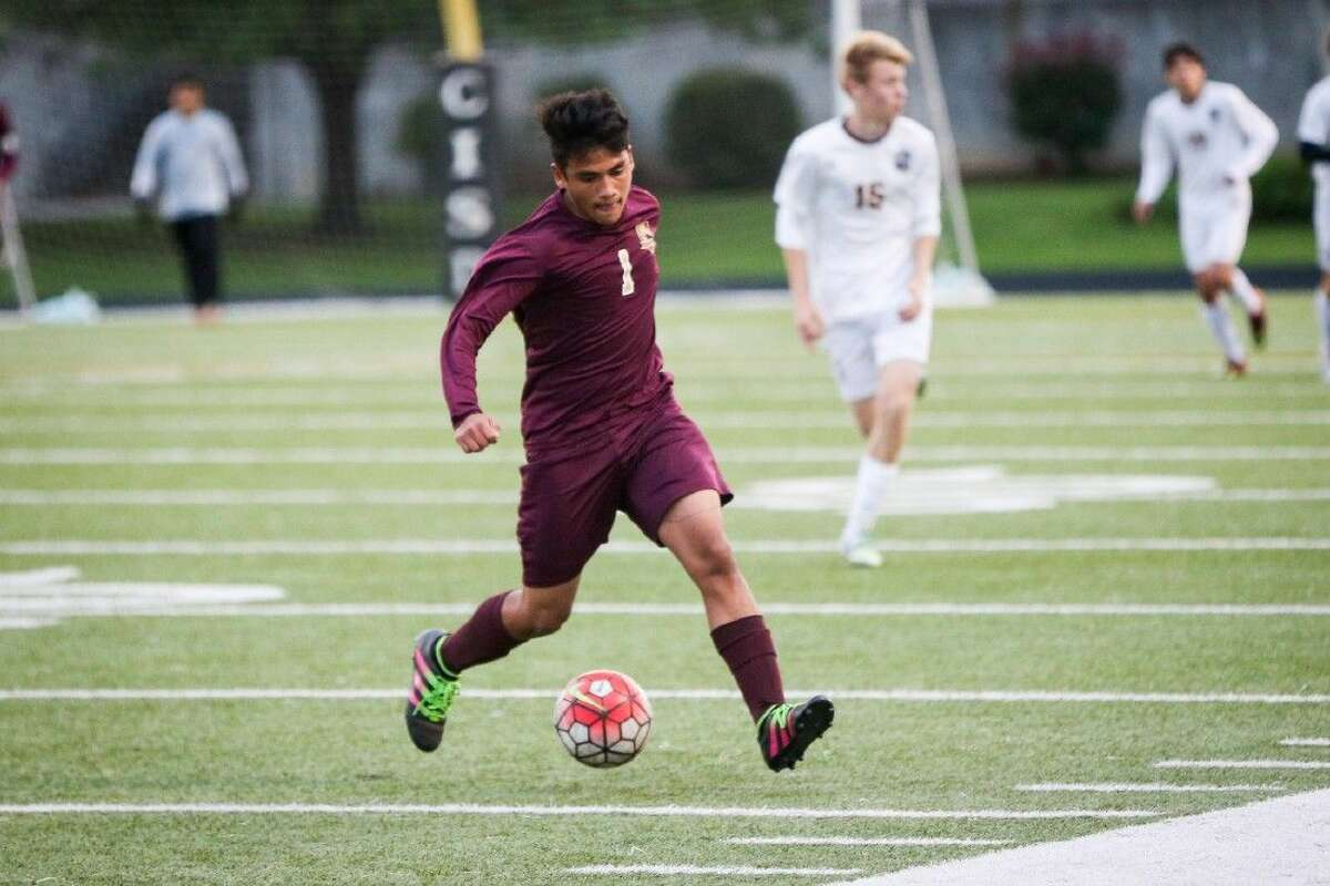 Magnolia West's Diego Ruiz (1) moves the ball during the high school boys soccer game against A&M Consolidated on Friday, April 1, 2016, at Moorhead Stadium. To view more photos of the game, go to HCNPics.com.