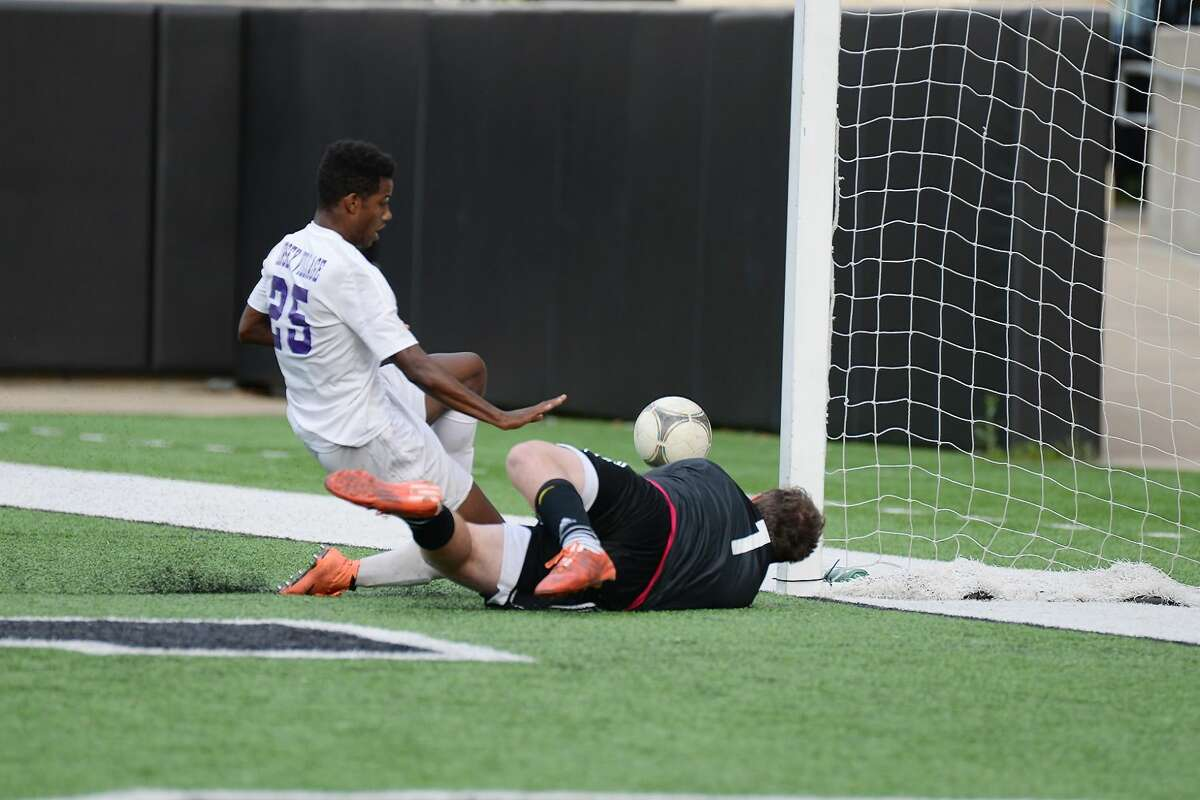 Jersey Village senior Jordan Henderson narrowly misses finding the back of the net against Seven Lakes senior keeper Connor Paxton Friday, April 1, 2016 at the Berry Center.