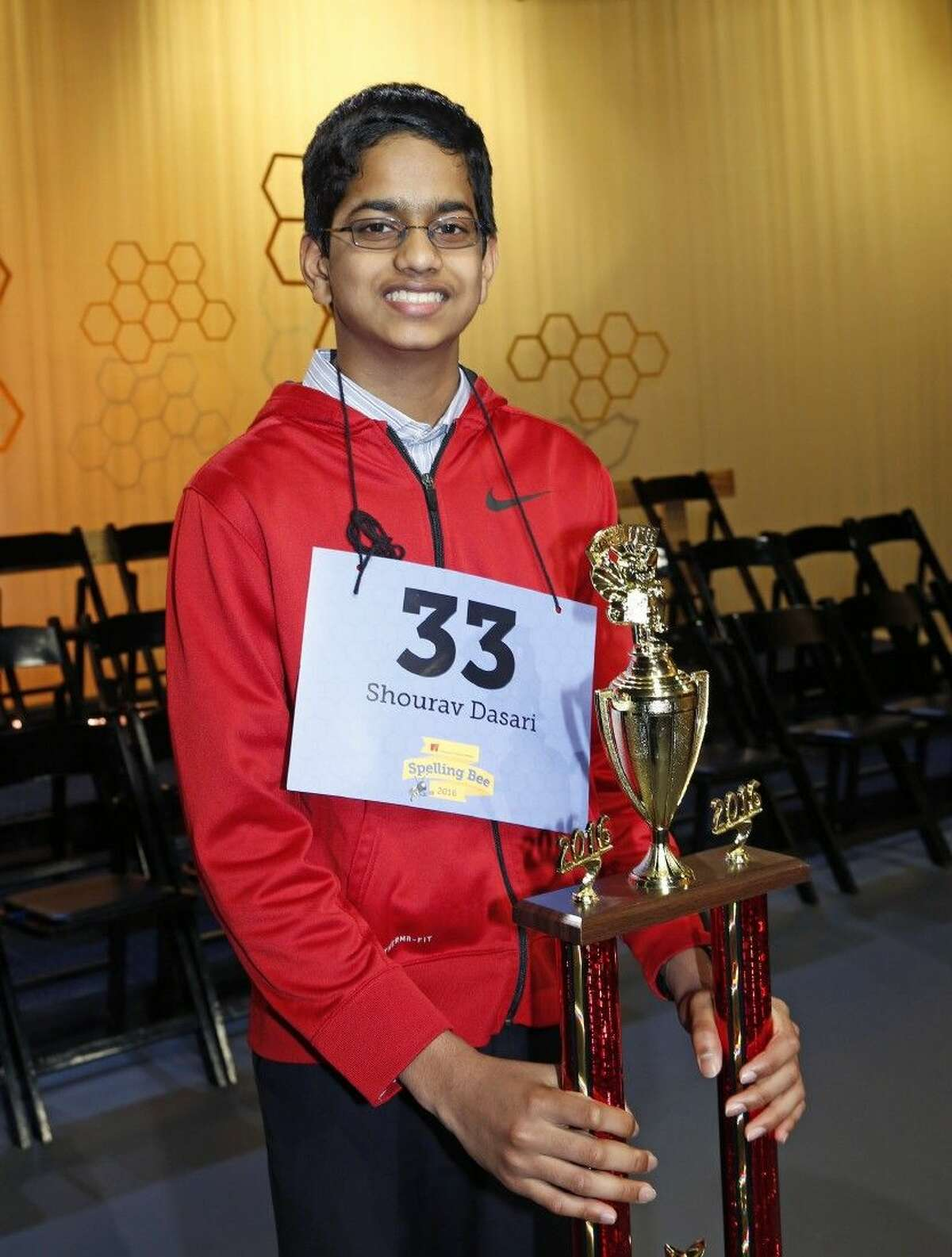 2016 Houston Public Media Spelling Bee co-champion, Shourav Dasari from McCullough Jr. High poses with his trophy after 14 rounds.