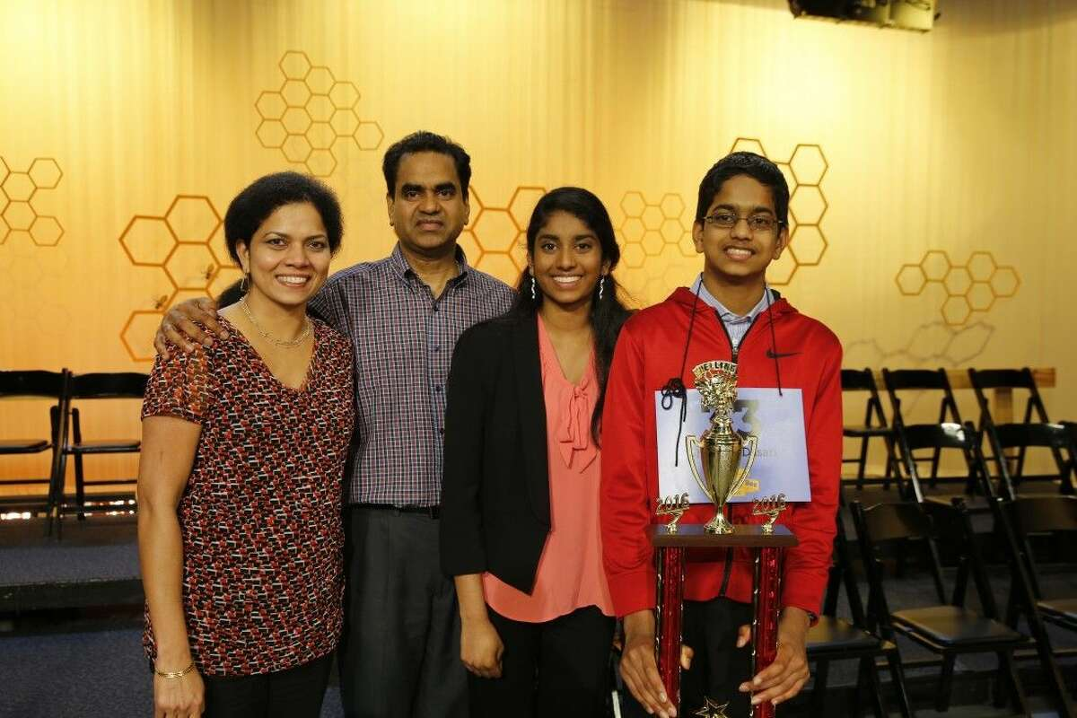 Co-champion of the 2016 Houston Public Media Spelling Bee, Shourav Dasari takes a celebratory photo with parents and his proud sister Shobha Dasari, former spelling bee champion.