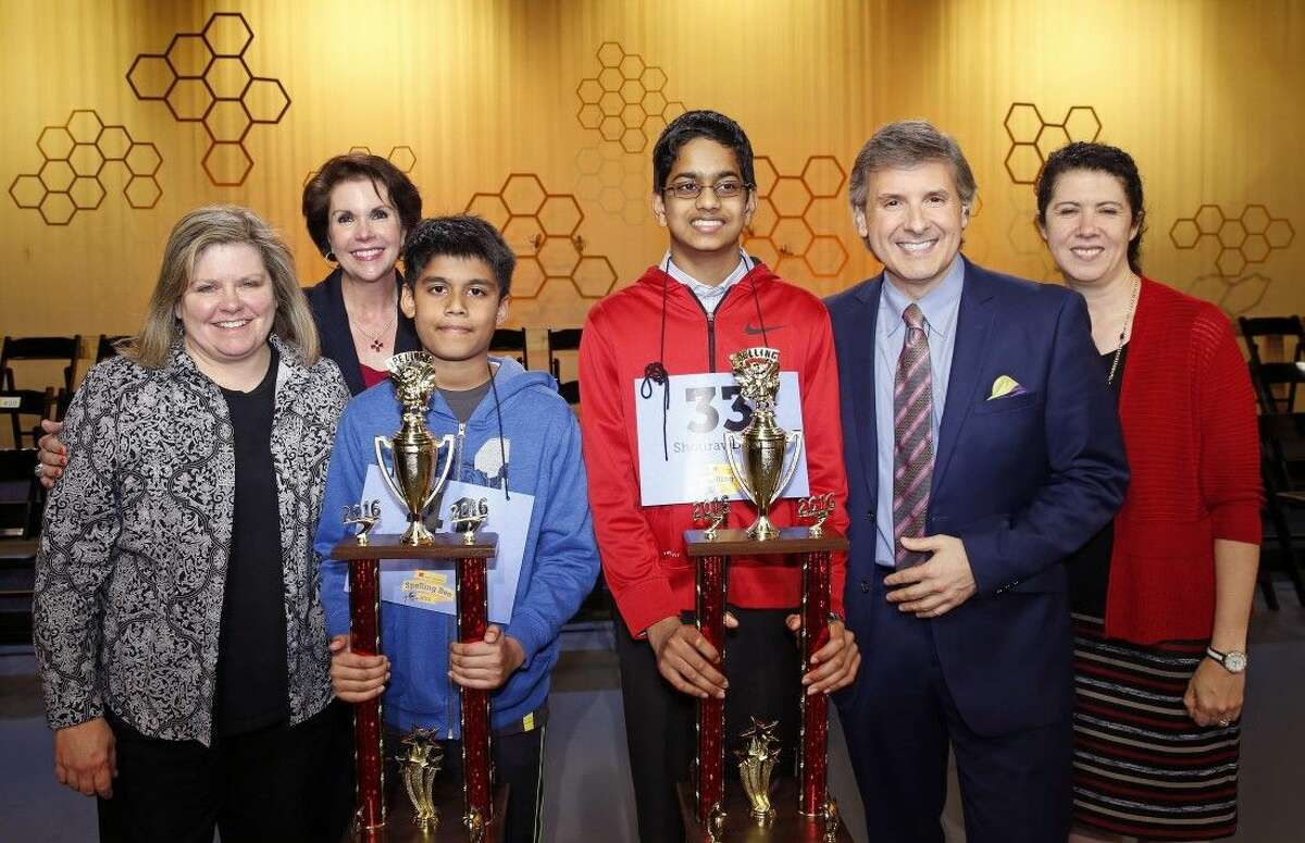 Photo by Craig H. HartleyThe 2016 Houston Public Media Spelling Bee co-champions celebrate their victory with representatives from Houston Public Media. From (L to R) Connie Hill, Houston Public Media's director of interactive education; Lisa Shumate, Houston Public Media's associate vice president and general manager; co-champion Nihar Janga from Austin; co-champion Shourav Dasari from McCullough Jr. High; Ernie Manouse, Houston Public Media's content producer; and Capella Tucker, Houston Public Media's director of content.