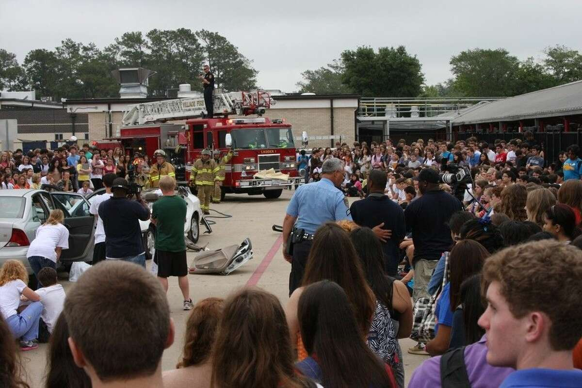 Nearly 1,200 juniors and seniors from Westside High School witness the unfolding rescue scene of a mock wreck to illustrate the dangers of underage drinking and driving during a 2012 Shattered Dreams presentation by Harris Health System. Since 2006, Harris Health has hosted an average of four Shattered Dreams a year at high schools in the districts of Houston, Channelview, Cy-Fair, Galena Park, Humble, Klein, Spring and Spring Branch.