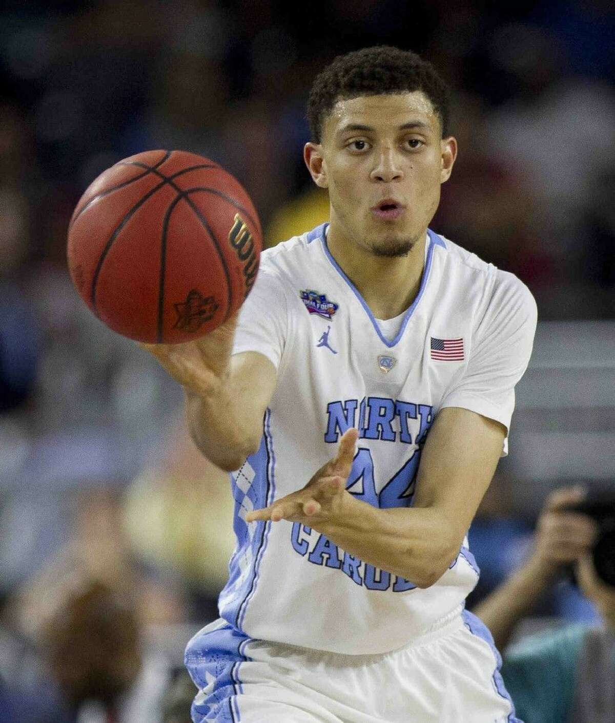 North Carolina guard Justin Jackson makes a pass during first half of an NCAA Final Four semifinal college basketball game Saturday, April 2, 2016, at NRG Stadium in Houston. Jackson was one of three Houston-area natives in key roles returning home for the Final Four.