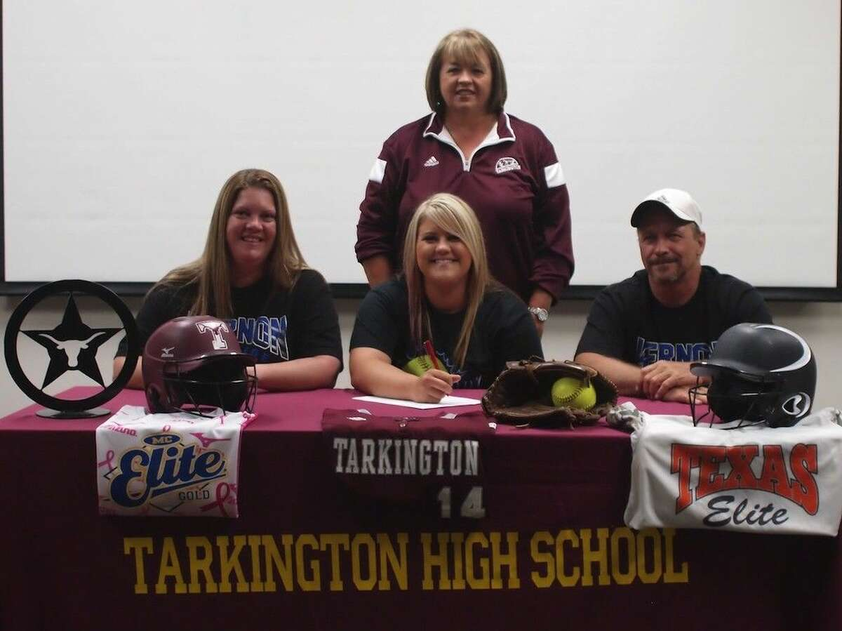Tarkington softball pitcher and first baseman Megan Hogan will soon be off to pitch for Vernon College in Vernon, Texas. She is seated here with her parents Kristi and Jesse Hogan, and joined by Tarkington Head Softball Coach Val Weldon.