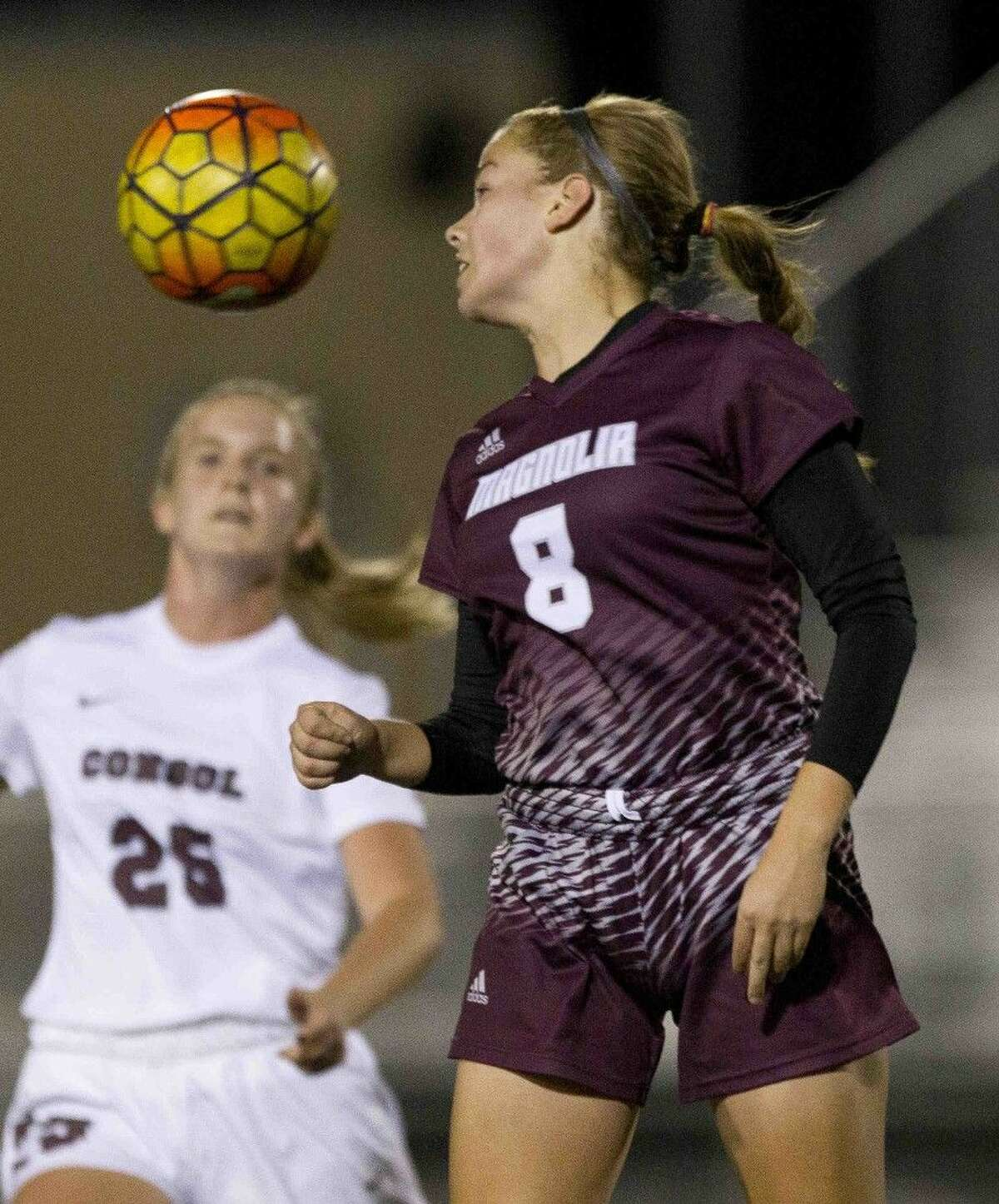Brooke Mallory, of Magnolia, flicks the ball during a Region III-5A area round playoff game at College Station High School Friday in College Station. Go to HCNpics.com to purchase this photo and others like it.
