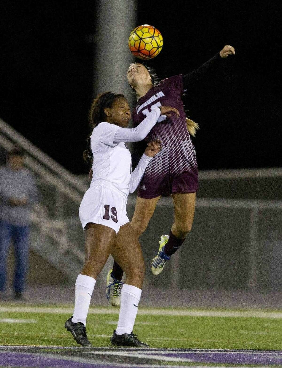 Erin Mooneyham, of Magnolia, heads the ball during a Region III-5A area round playoff game at College Station High School Friday in College Station. Go to HCNpics.com to purchase this photo and others like it.