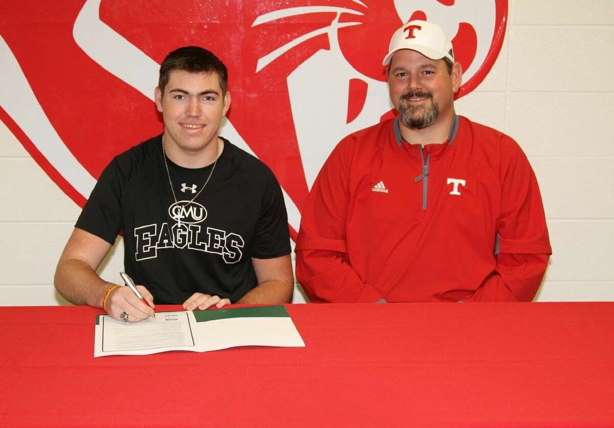 Tomball quaterback Mason Jones is joined by head coach Danny Ramsey as he signs his National Letter of Intent to play football at Central Methodist University.