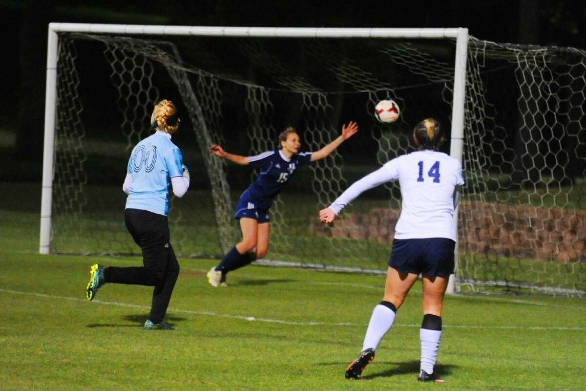 Tomball Memorial forward Avery Ortmann watches her shot soar into the back of the net for the game-winning goal Friday night at Rankin Field in Brenham during a 1-0 playoff victory over Bryan.