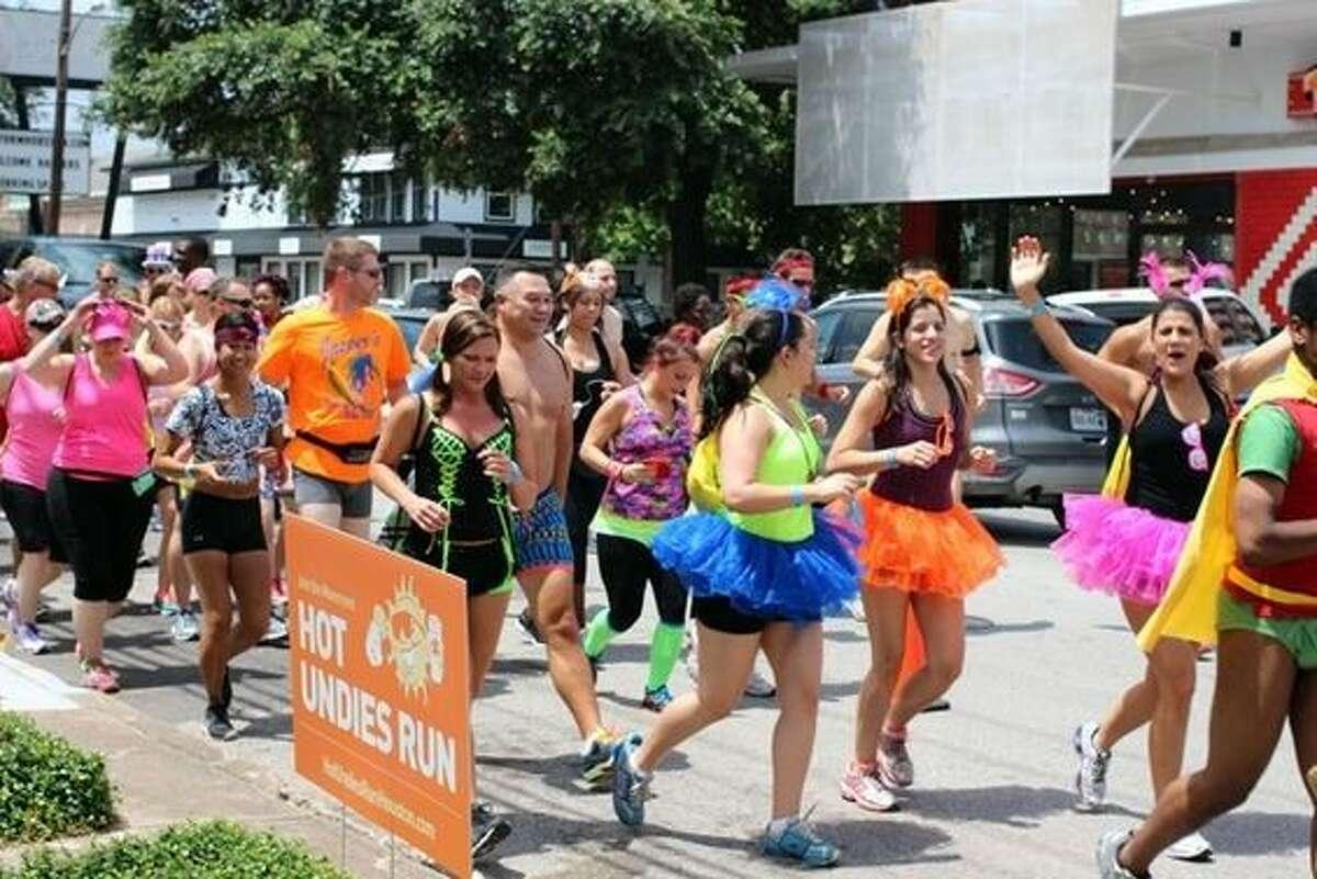 Participants in the Hot Undies Run make a two mile trek through Rice Village in their underwear.