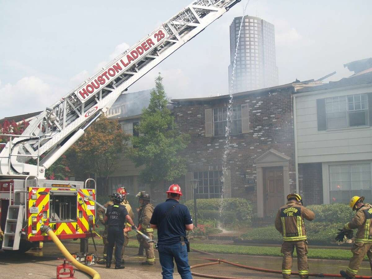 Nearly 100 firefighters battle a three-alarm fire at the Tanglewest Town Homes on Valley Forge. No residents or firefighters were injured in the blaze.