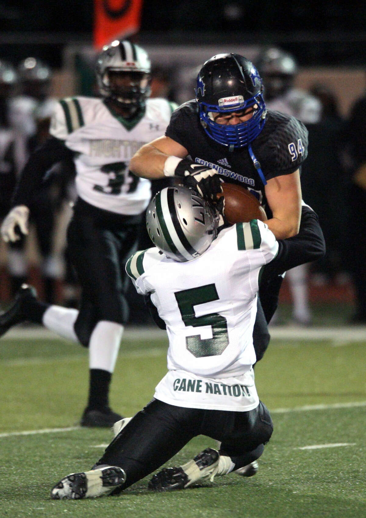 Hightower defender Jared Gill (5) puts the stop on Friendswood runner Eric Langston (94) Friday night in Alvin.
