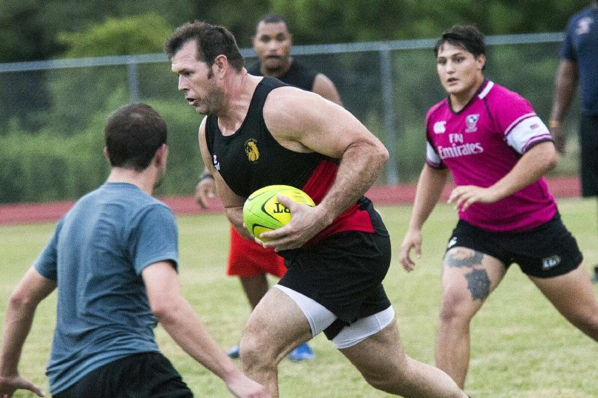 Justin Kincheloe attempts to break through the pack during a Kingwood Crusaders training session July 30, 2015, at Creekwood Middle School.