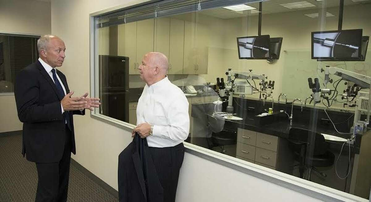 U.S. Rep. Kevin Brady, left, with Ototronix CEO Mike Spearman tours the facility in The Woodlands, the state's only manufacturer of hearing implant devices.