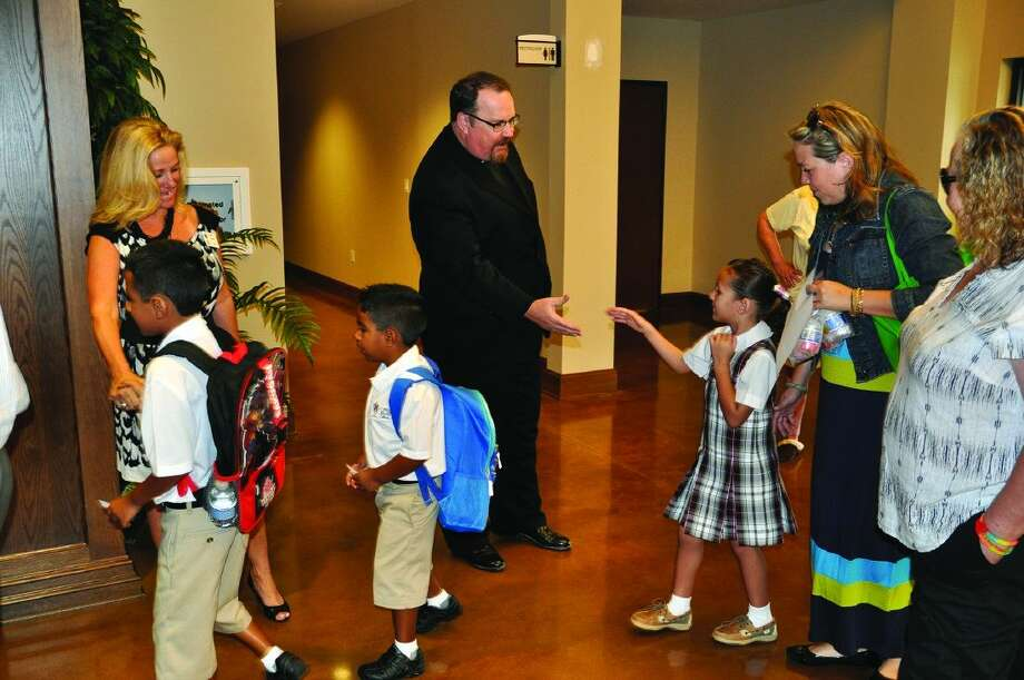 First day of school at Christ the Redeemer Catholic School with Principal Betty Sierra and Pastor Rev. Sean Horrigan. Photo: Jonah Dycus