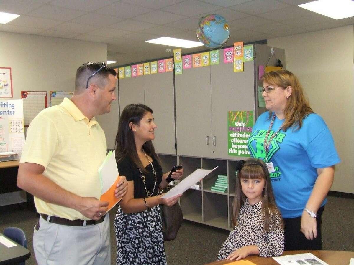 Bernshausen Elementary second-grade teacher Sara Smith talks with parents Nick and Denise Doud on Meet the Teacher night on Thursday, August 21.