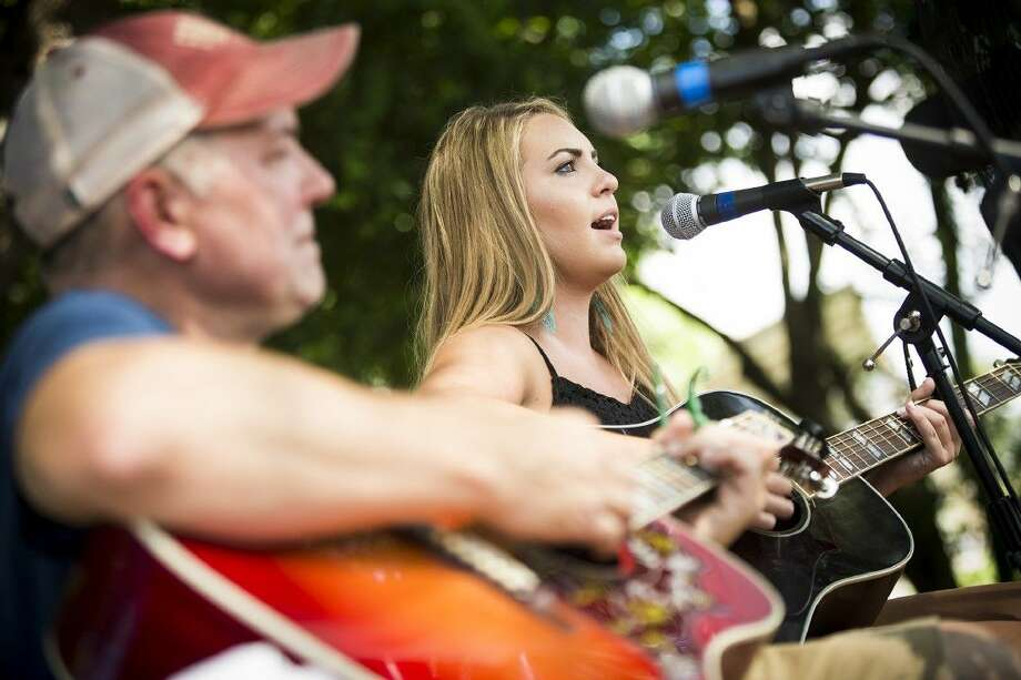 Kaitlyn Harvey sings and plays guitar with her guitar teacher Derek Thibodeaux during a performance at Cedar Landing on July 19, 2015, in Huffman. Harvey wants to begin writing her own music and wants to make it to Nashville to continue her career in the next five years. Photo: ANDREW BUCKLEY
