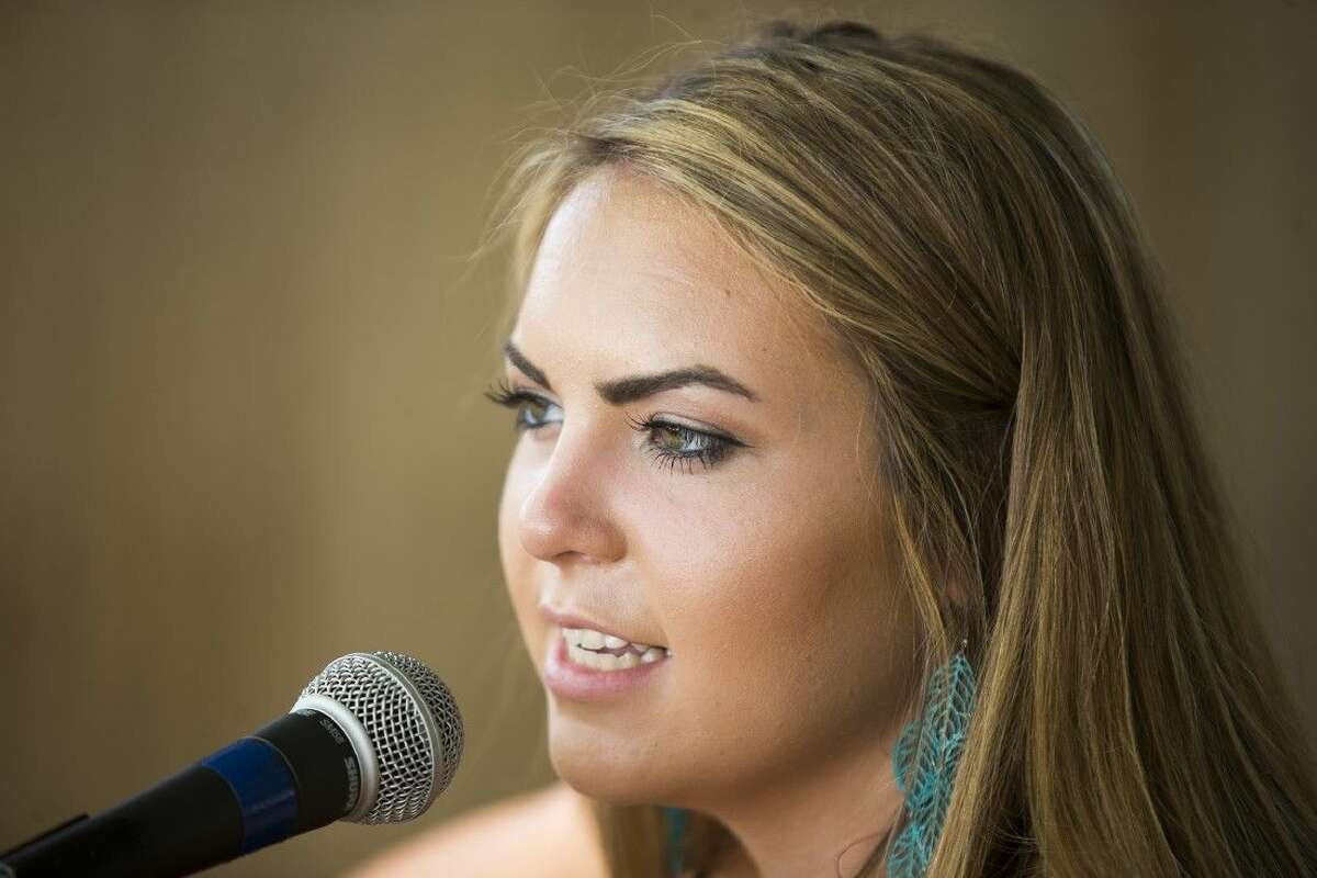 Kaitlyn Harvey sings to customers at Cedar Landing on July 19, 2015, in Huffman.