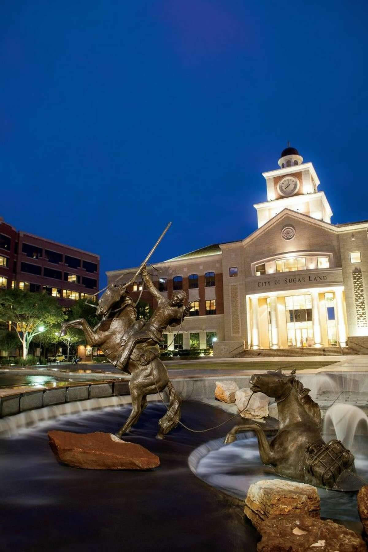 The guide includes information on quality of life amenities and attractions, such as Sugar Land Town Square.