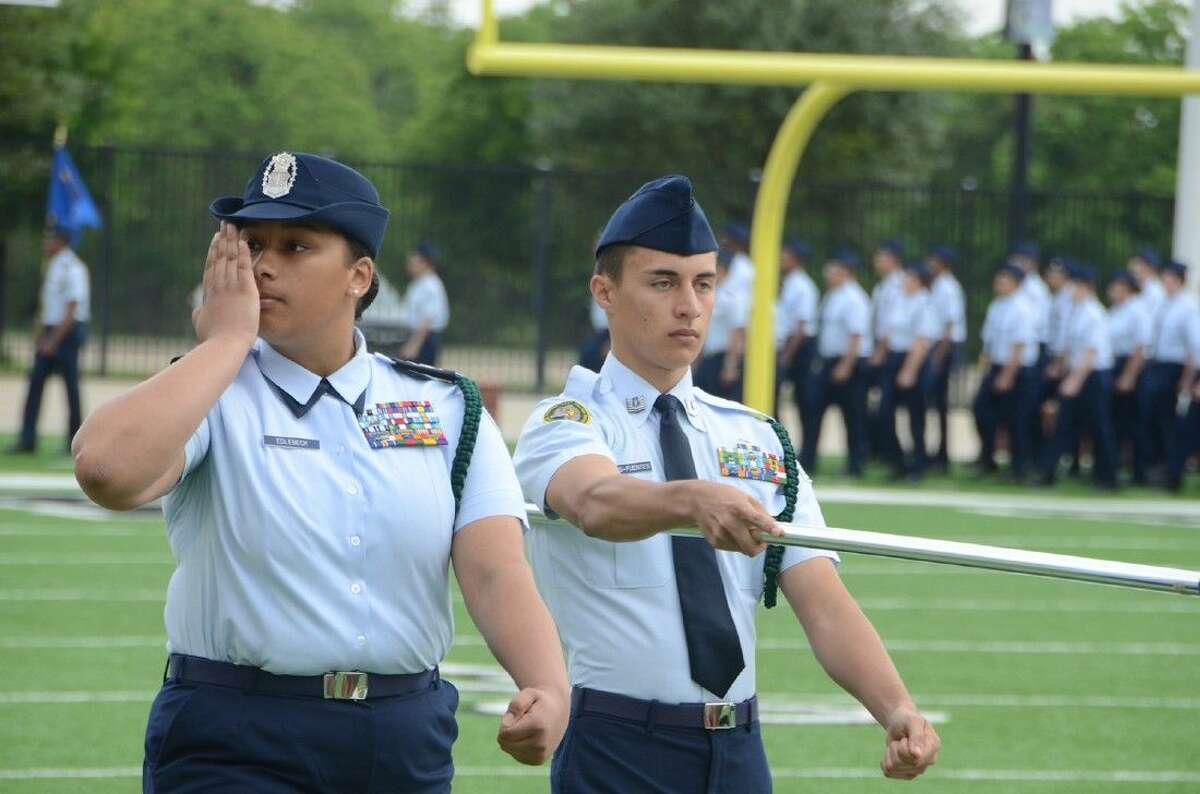 Cypress Falls High School senior cadets Christina Edlebeck, left, and Braden Morris-Fuentes, of AFJROTC Unit TX-20003 pass by the reviewing official during the 2015 Pass in Review event at the Berry Center. The 2016 event is scheduled for April 16.