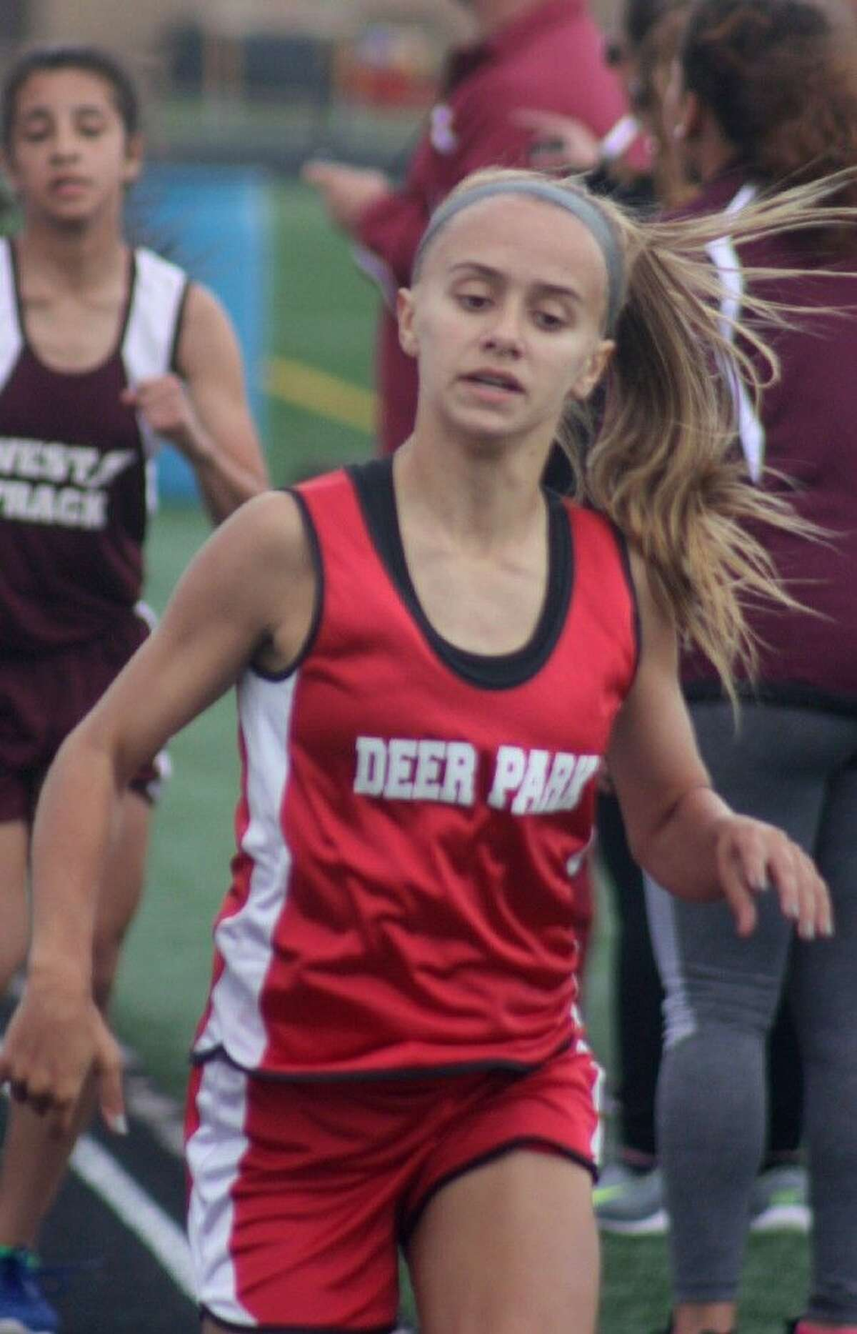 Audrey Addison comes across the finish line in the 800-meters for the first of her two titles at the conference district track and field meet. She was the only athlete from Deer Park ISD to score points in the 800 and 1600 and nearly the eighth grade as well.