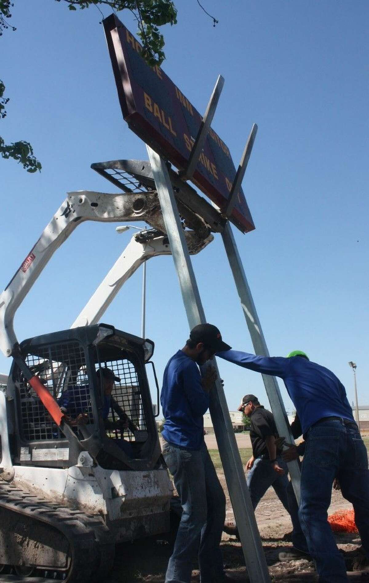 Construction on the city's new youth baseball complex was taking place right down to the last minute as workers install a scoreboard at Field 4 Monday afternoon.
