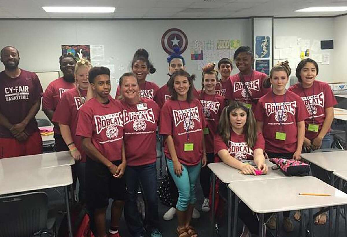 Students in Julie Rohan's class celebrate the final day of Algebra Camp at Cy-Fair High School on July 30.