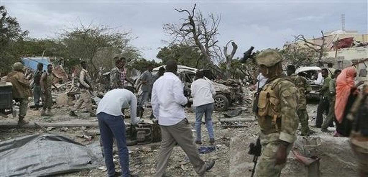 Security forces secure the scene of a suicide car bomb attack in the capital Mogadishu, Somalia Sunday. A Somali police officer says a suicide car bomber has rammed his car into the protective perimeter outside a well-known hotel in the Somali capital Sunday, killing at least four people.