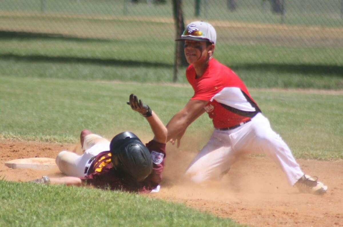 The Sluggers second baseman applies the tag to Deer Park All-Star Canen Adrian, who was trying to steal second base during third-inning action Sunday afternoon. Deer Park saw its quest for a trip to California end with the 12-2 loss. Deer Park was one of the final three, finishing with a respectable 3-2 record.