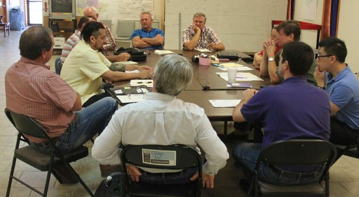FEMA Public Assistance Crew Leader Joseph Avila (left) gives a presentation on public assistance for San Jacinto County.