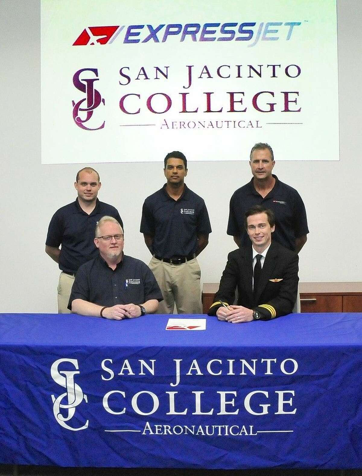 Pictured (left to right, front row): Mark Deschner, San Jacinto College transportation department chair, and Matthew Applegate, first officer and pilot recruiter with ExpressJet Airlines. (left to right, back row) Scott Griffith, San Jacinto College career pilot instructor; Travis Barker, San Jacinto College career pilot program director; and Dan Rumley, assistant chief for ExpressJet Airlines in Houston. Photo credit: Jeannie Peng-Armao, San Jacinto College marketing, public relations, and government affairs department.