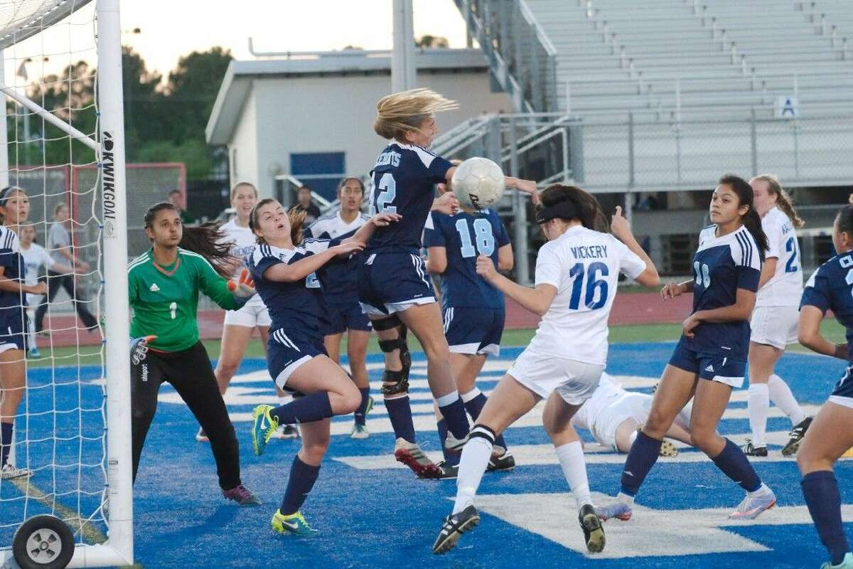 Fort Bend Clements' Catherine Boring (2) and Mary Alex Senften (12) protect the goal against Friendswood's Selina Vickery (16) Tuesday night at Henry Winston Stadium.