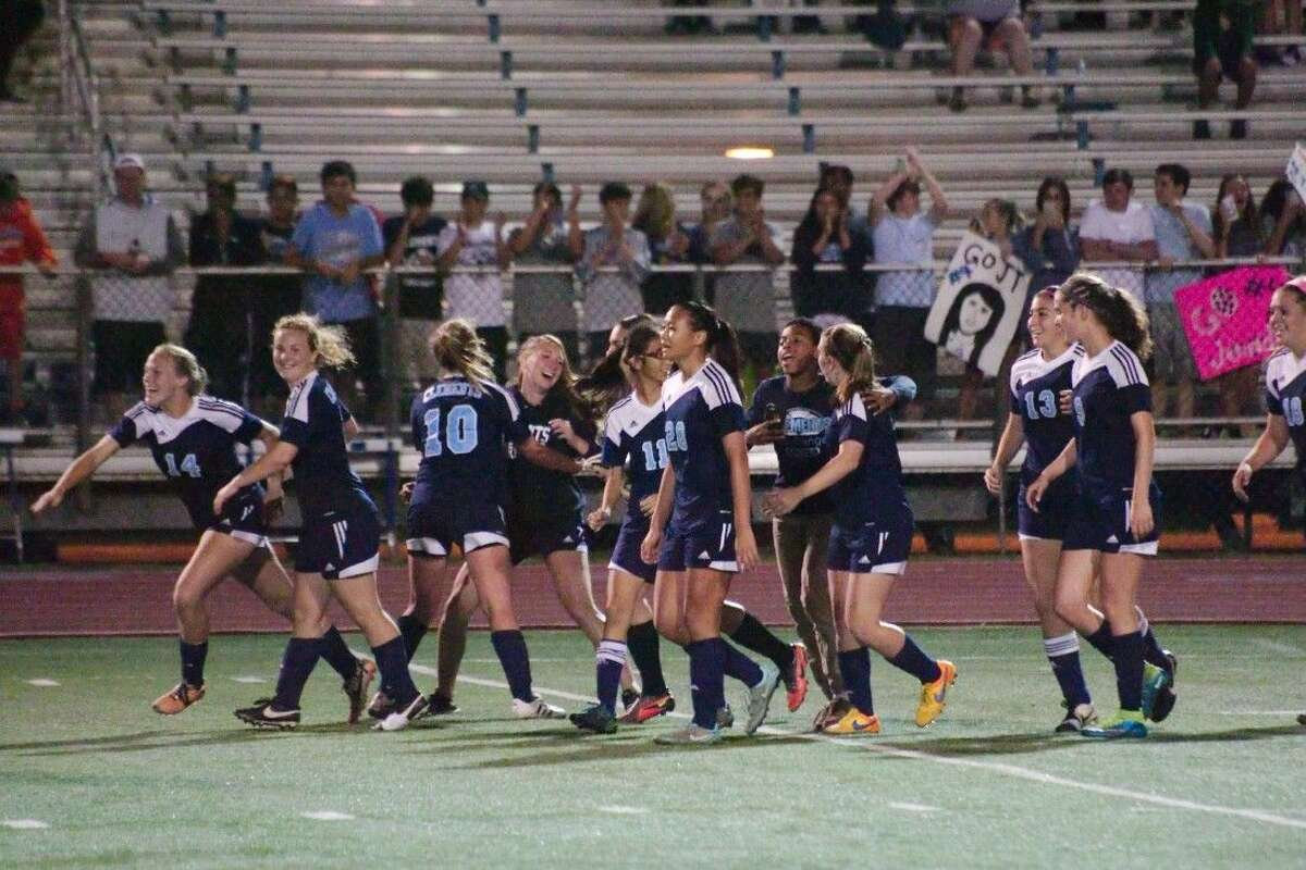 Fort Bend Clements players celebrate their 1-0 overtime victory against Friendswood Tuesday night.