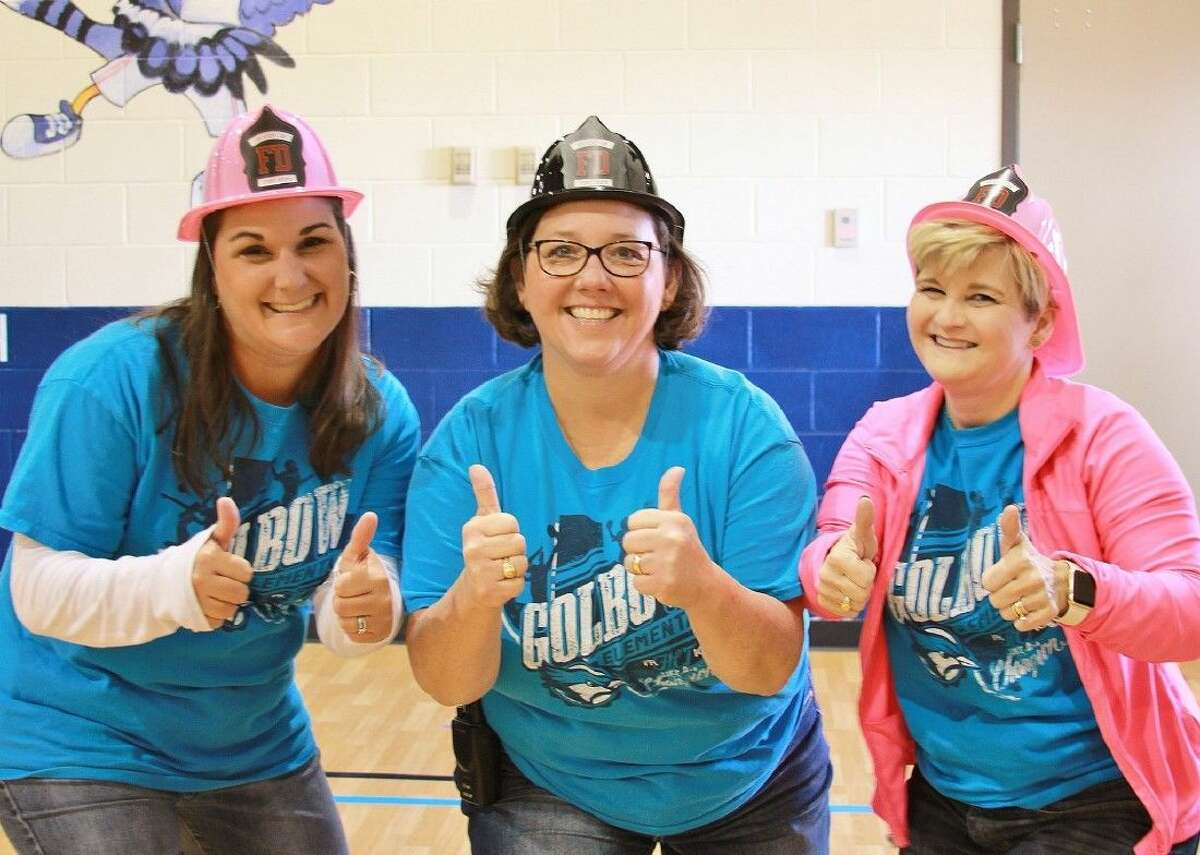 Golbow Elementary staff strike a pose for the camera at the school's Health and Safety Fair. The goal was to help educate the Golbow students and their families on how to make healthy choices, stay active and be safe.