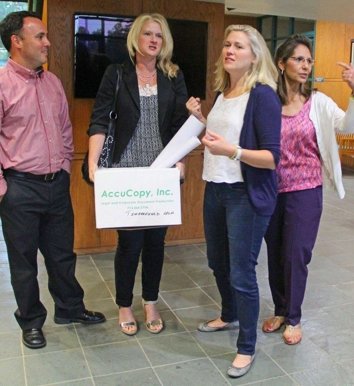 Timberfield Estate Homeowners Association President Amy Faber (center) and other neighborhood residents spoke at a recent city council meeting about concerns related to the Whispering Pines road expansion project.