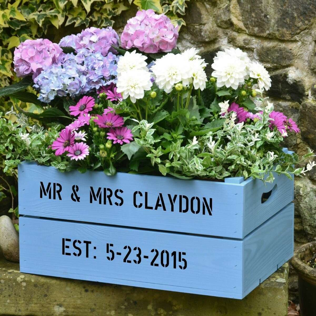 Crates, recycled or purchased, can be painted and personalized to create a colorful, unique planter for flowers and edibles. Photo credit: courtesy of PersonalizedCrates.com