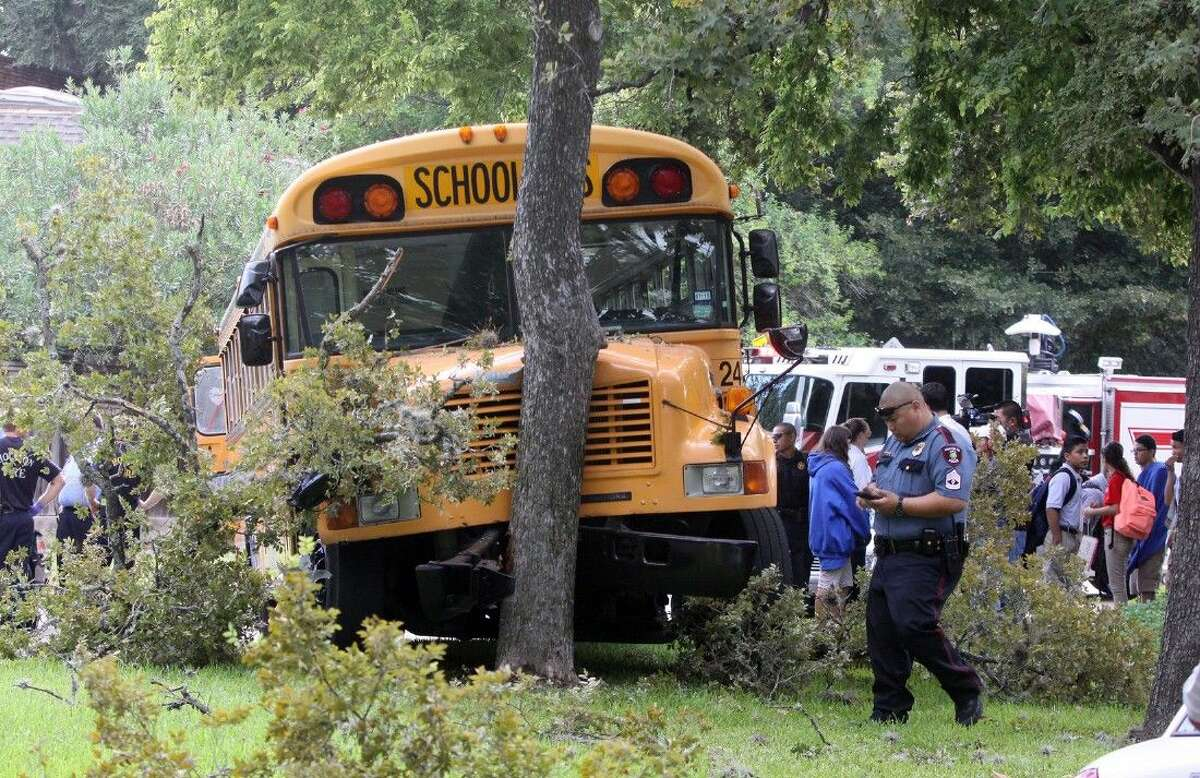 A school bus from Nancy's Bus Service hit a tree while transporting students at Briar Forest Drive in west Houston, Texas on Tuesday, August 26, 2014. Fourteen victims were being transported to nearby hospitals for minor injuries.