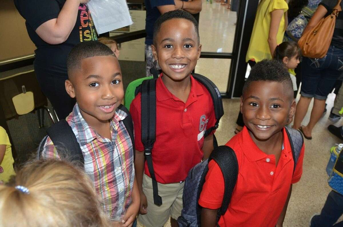 Students at Bang Elementary School prepare to head to class on the first day of school.