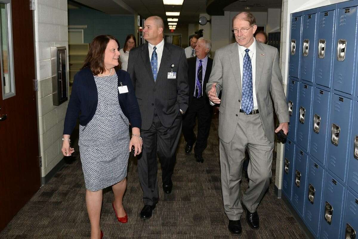 Anthony Middle School principal Sherma Duck takes current superintendent Dr. Mark Henry and former superintendent Dr. David Anthony through the halls of CFISD's 18th middle school on the first day of school Monday.
