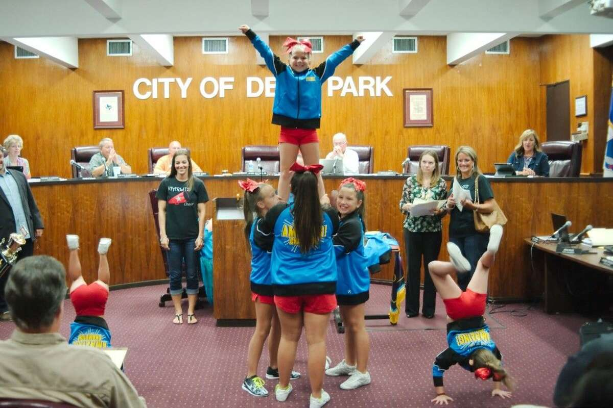 Members of the Deer Park Texas Starlitz cheer team perform after being recognized by Deer Park Mayor Jerry Mouton, Jr. and the Deer Park City Council for taking first place in the Amazing charity cheer competition in San Antonio and donating their $1,000 winnings to the Make a Wish Foundation Tuesday.