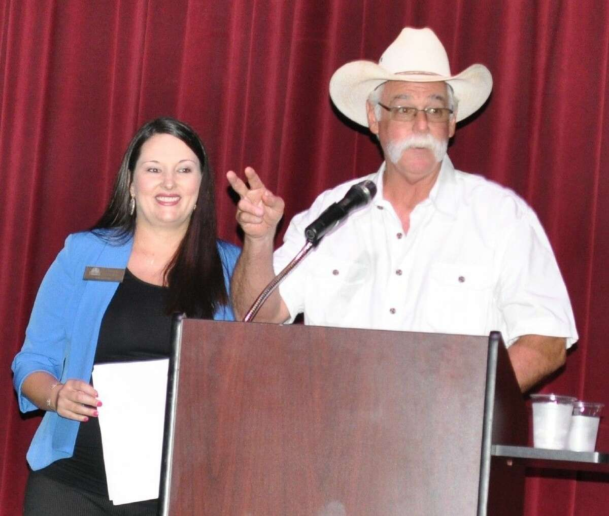 Mark Beaver, auctioneer is assisted by Christina Womack for a fast paced live auction at Art Park Theater.
