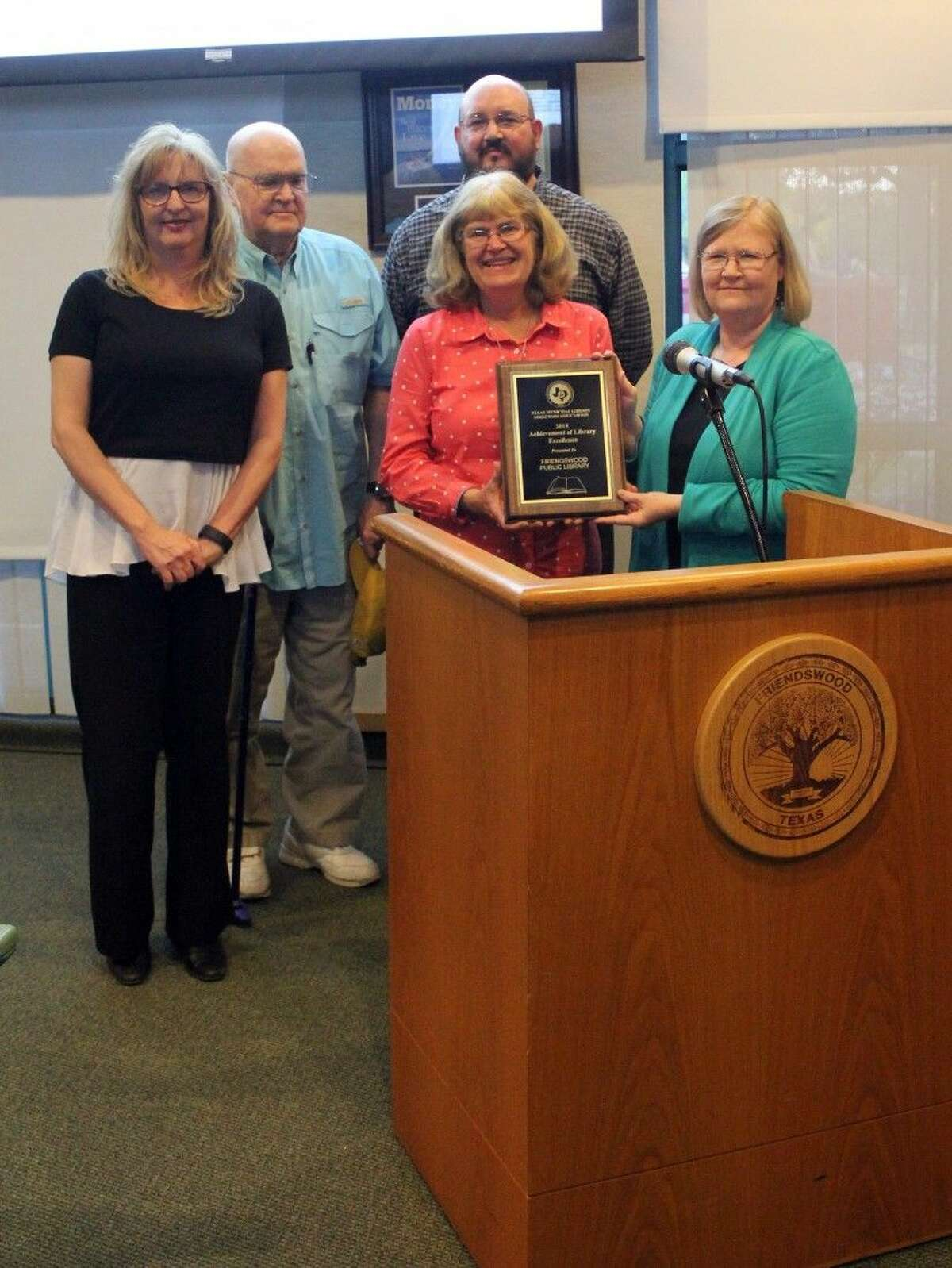 The Friendswood Public Library was recently honored by Mayor Kevin Holland and the City Council for receiving the 2015 Achievement of Library Excellence Award from the Texas Municipal Library Directors Association. Pictured from the left: Library Board Members Ruth Law and Ted Thomas, Library Director Mary Peroni, Assistant Library Director Matthew Riley (in the back) and library assistant Karen Hart.