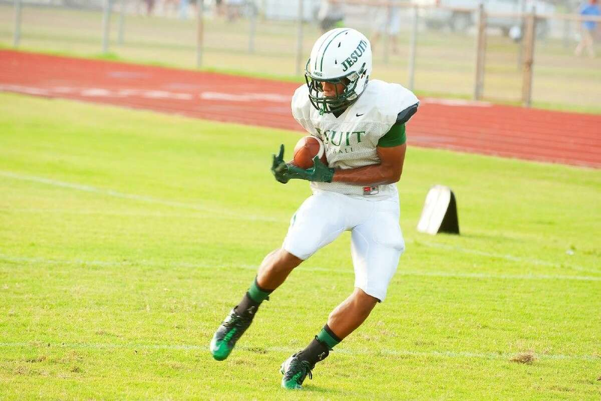 A Strake Jesuit receiver pulls in a pass during the Crusaders' scrimmage last Friday night at Cy-Fair. The Crusaders will kick off the 2014 season Friday night in Aldine at Thorne Stadium, taking on Aldine in their own backyard. Aldine was 0-10 in 2013 and the Crusaders are hoping to extend that losing streak one more game.